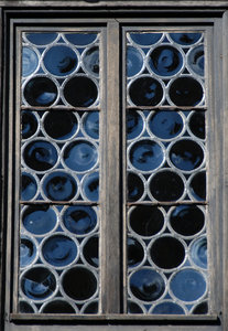 Medieval window: Window with roud glasses  in medieval castle Burg Falkenstein, Germany