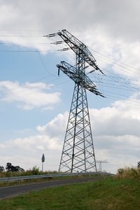 Suspension tower in Germany 1: Electricity pylon or transmission tower is a tall, usually steel lattice structure used to support overhead electricity conductors for electric power transmission.