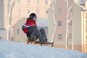 Boy on the sledge 4: Kid's ride on the sled at winter