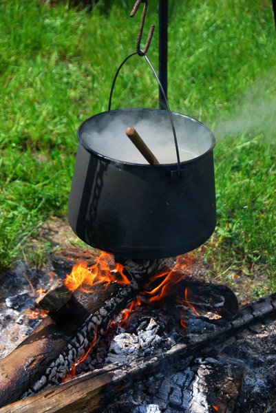 Kettle over the fire 2: Camp-fire with hanging over pot