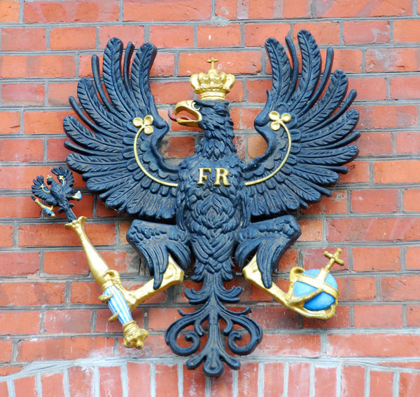 Black eagle with crown, orb an: State sign on the wall of fortress in Berlin Spandau