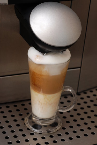 Making of coffee latte macchia: Coffee machine by work