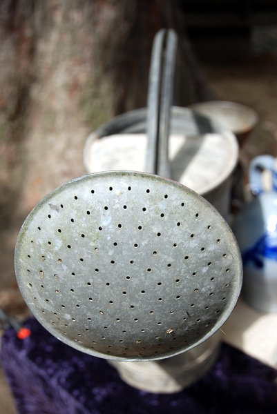Watering can: Watering can is a portable container, usually with a handle and a spout, used to water plants by hand