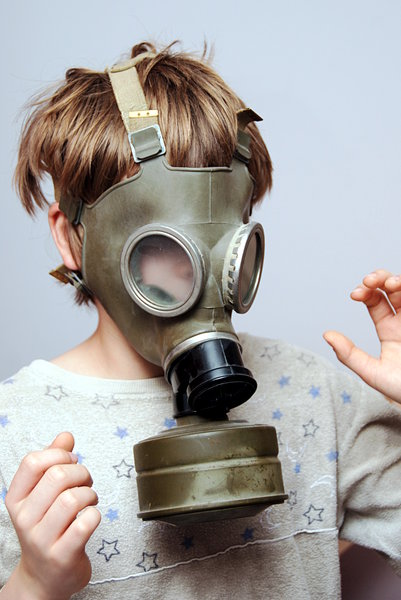 Boy in the soviet gas mask  5: Mask worn over the face to protect the wearer from inhaling airborne pollutants and toxic materials