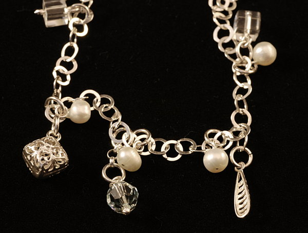 Silver bracelet with pearls an: Wristlet