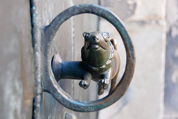 Brass gate handle: Door handle from side gate of church St. Servatius in Quedlinburg, Germany
