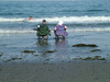 Retired and relaxing: An older couple relaxes on the beach in New Hampshire.