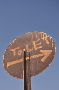 Crude signboard: A make-shift hand painted signboard for a toilet in Jaisalmer, Rajasthan, India.