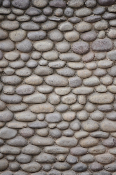Pebble Wall Texture: A pebbled wall texture from the famous Rock Garden in Chandigarh, India.