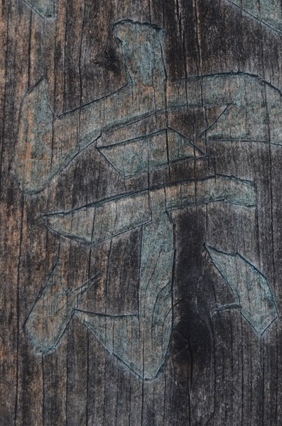 Japanese character on wood: Worn wood grain texture with a Japanese letter inscribed upon it.