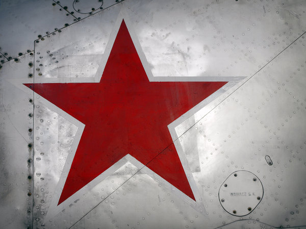 star: I found an old MIG 21 near the side of the road and took some miserable snapshots.