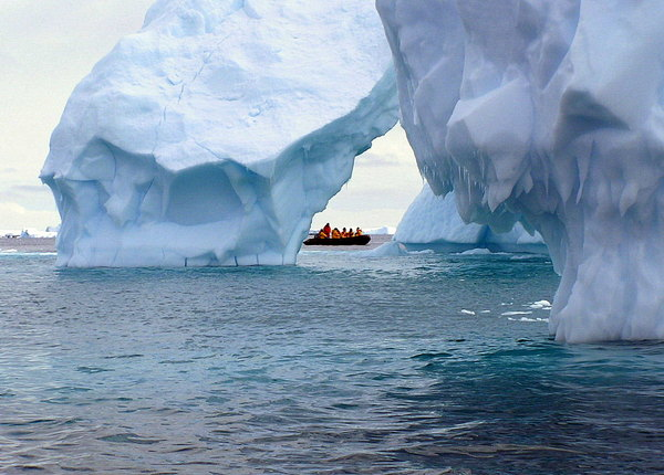 Iceberg cathedral: Looming over the zodiac, the icebergs seem to go on forever.  This was a chance shot when the zodiac happened to cross a small open area.