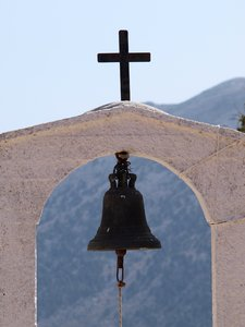 Cross and bell: Cross and bell on top of a small Greek Catholic mountain church