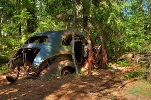 Disintegration - HDR: Old car left en a forest in Sweden. The picture is HDR using five images.