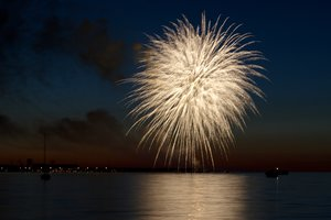 Fireworks on water: Fireworks on the coastline with lots of reflections and boats in the water