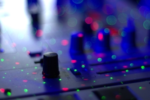DJ mixer: DJ mixer with spots from laser light. Narrow depth of field.