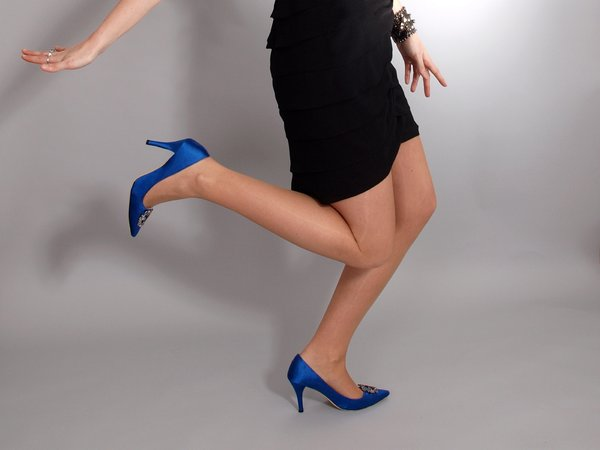 Woman with high heels: Woman posing dressed with high heels and a black dress