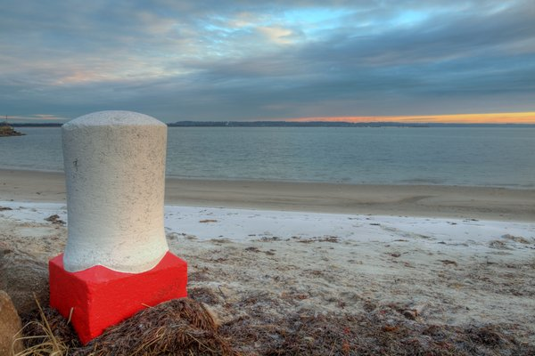 Bollard - HDR: A large bollard at the beach. The picture is HDR.