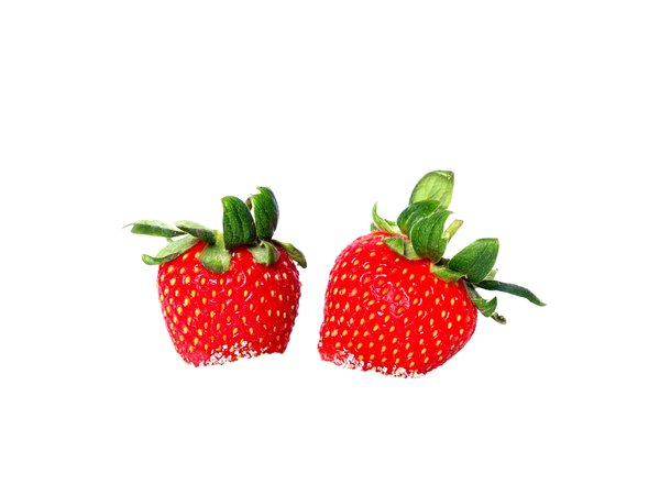 Strawberries in sugar: Two strawberries in white sugar giving a bourned out background