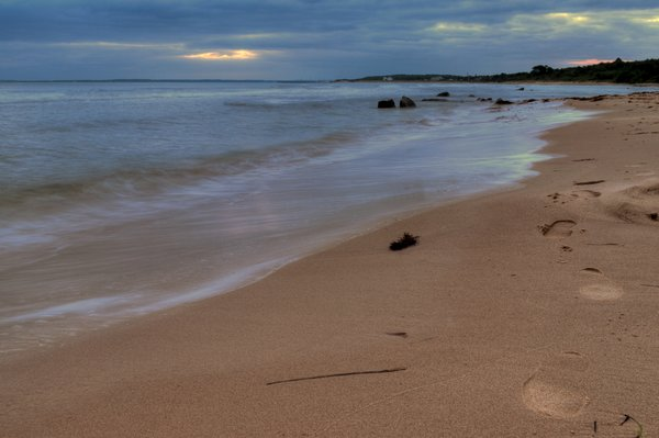 Footprints on the beach - HDR: Footprints on the beach in early morning light. The picture is HDR.