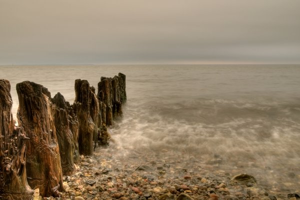 Sea teeth - HDR: The remains of a wooden breakwater. The picture is HDR using six images.