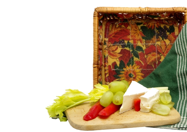 Cheese collation: Collation with Brie cheese, grapes, peber and celery with basket and tea towel