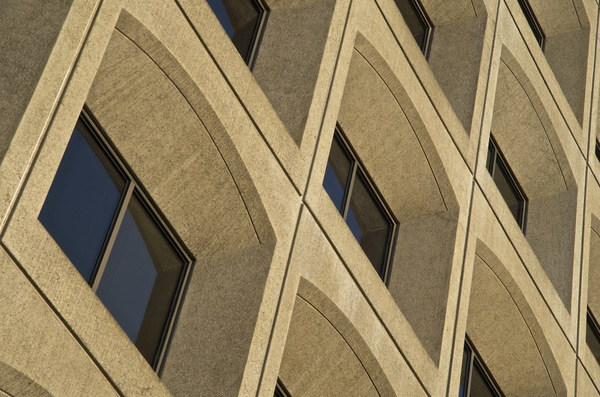 office building windows: three windows of office building illuminated by morning sun