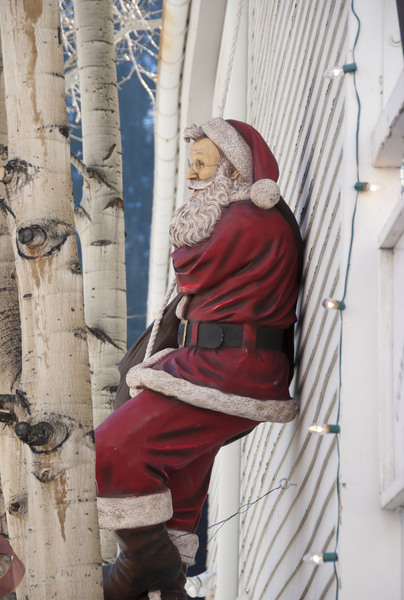 Santa Claus: Santa leaning against exterior of house in winter