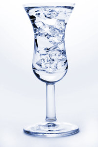 glass: water tap and dropping water,glass with ice cubes,