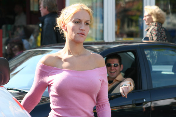 street: woman in pink blouse