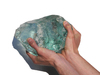 Hand holding glass: A big piece of shiny glass hold by my hands