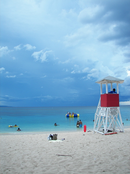 Jamaican Baywatch: Beach at Montego Bay on Jamaica. The sky became  cloudy and caused a strange contrast between the sky and the sea colors.