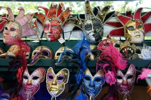 carnival mask display: assorted colorful Venice styled festive masks