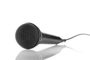 Microphone: an isolated microphone with reflection.