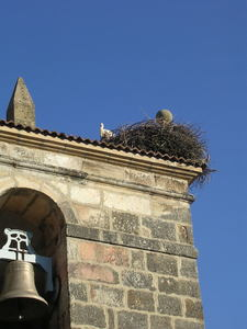Stork nest in Navaleno: Navaleno, Soria, Spain. The stork's nest in the roof of the church