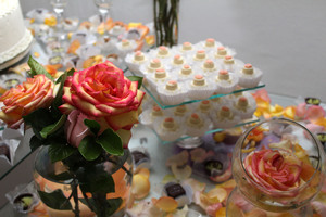 Wedding cake at reception: bride, cake, cutting, decoration, flower, fruit, groom, icing, reception, sponge, tier, wedding