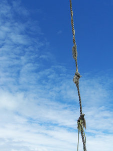 Swinging rope: Rope swinging against blue sky