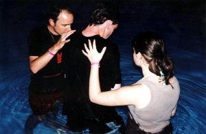 The Baptism: adult Christian baptism at night.  Too dark?  Is a scanned photo taken with cheap camera, still grainy, sorry.  Just thought the subject might be useful.