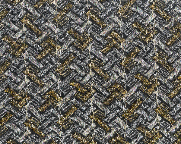 gold and white silver gauze fa: Patterned see through fabric on black background.  Gold and silver thread in a brick-like herringbone pattern