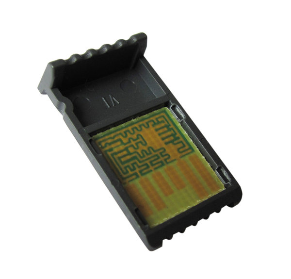Coding chip macro: Chip originally used for coding a blood glucose meter. Isolated, clipping path included.