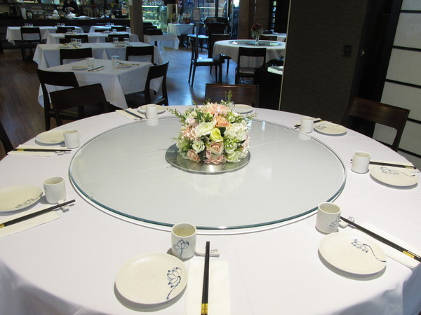 Interior of a restaurant: A restaurant with tables, seats and white table clothes for your special occasion