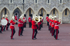 Military band: A military band participating in the ceremony of the Changing of the Guard at Windsor Castle, England. Photography of soldiers participating in this ceremony is freely permitted.