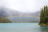 Rainbow over a lake: A rainbow over a lake in the Rockies, Canada.