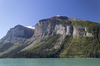 Lakeside cliffs: Lakeside mountains and cliffs in western Canada.