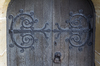 Ornamental cast iron: Ornamental cast iron scrollwork on a church door in West Sussex, England.