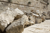 Jerusalem Temple stones: Huge stones hurled down by the Romans during the destruction of the Jewish Temple built by Herod in Jerusalem, Israel; hence about 2,000 years old. Smaller stones higher up in the wall are later renovations/alterations by other people groups. Photography