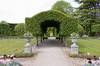 Topiary arch: A formal garden with topiary arch at Holker Hall, Cumbria, England. Photography in the grounds of this stately home was freely permitted.