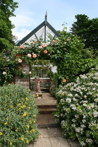 English greenhouse: A greenhouse in the garden of an English country house.