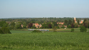 Rural train: An electric train travelling through a rural area of West Sussex, England.