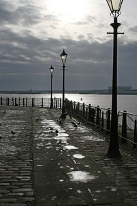 Moody wharf: A wharf by the River Mersey, Liverpool, England, in moody winter weather.